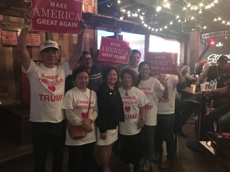 Members of Chinese Americans for Trump doing voter outreach.