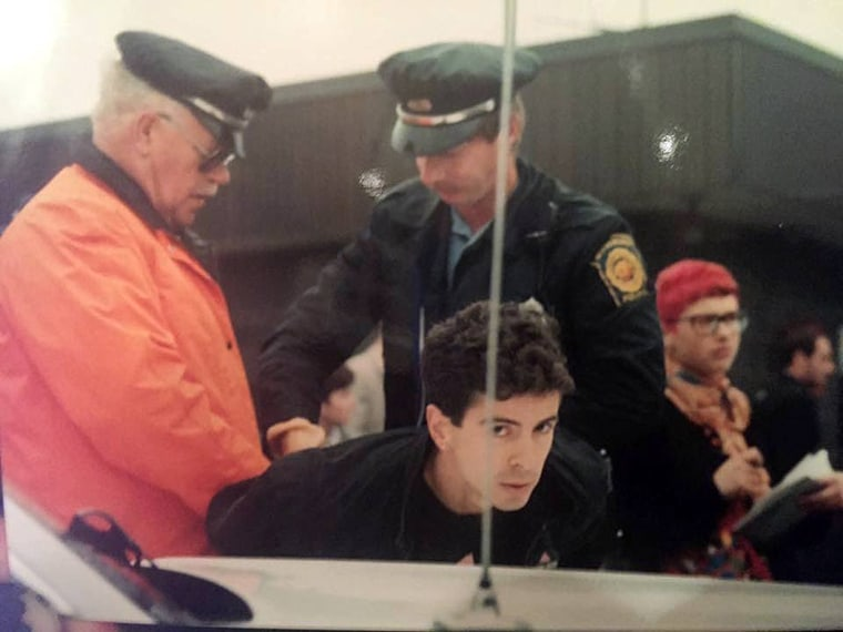 Image: AIDS activist Peter Staley is arrested after demonstrating for better access to HIV drugs outside Astra Pharmaceuticals