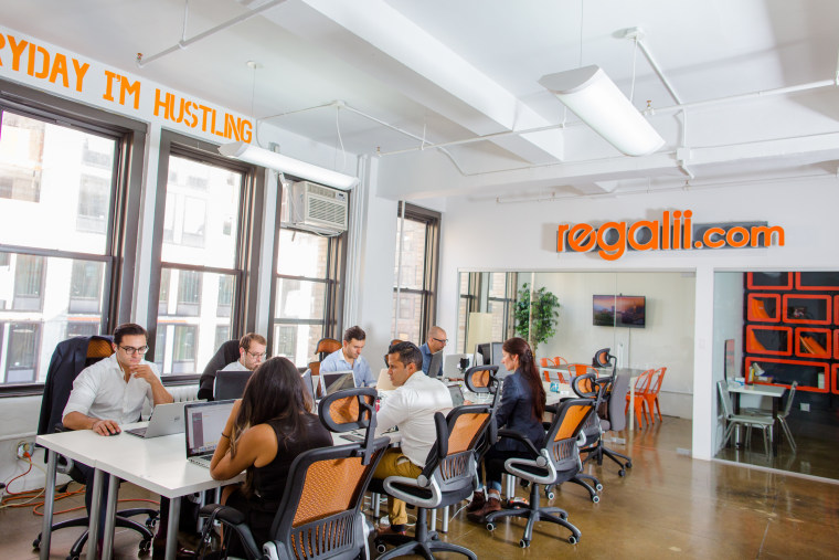 A picture of the Regalii team in their New York City offices. Their technology platform serves the $3 trillion global and domestic bill payments market.