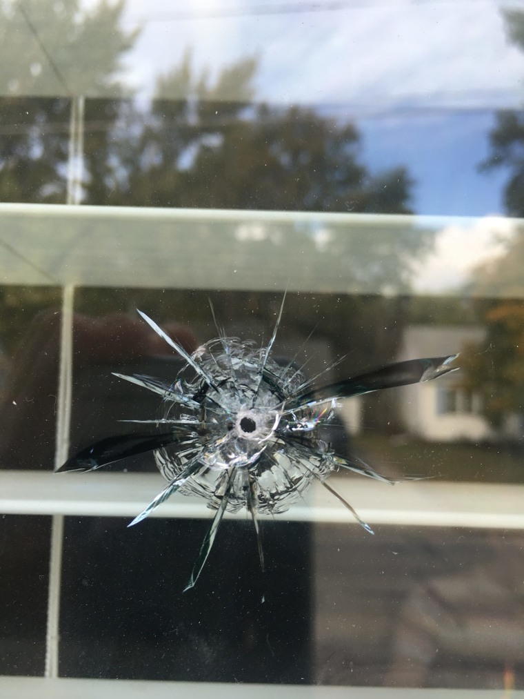 One of seven bullet holes that broke through a window on the north side of the house.