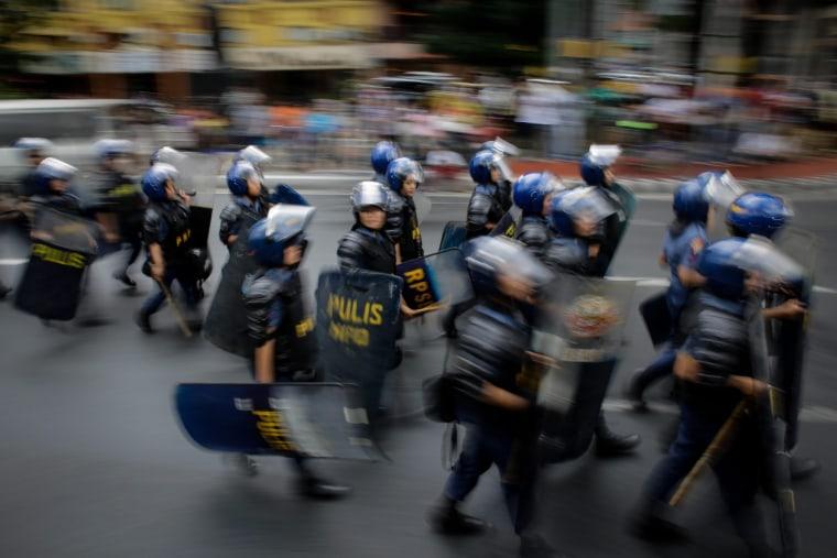 Image: Filipinos protest at US Embassy in Manila