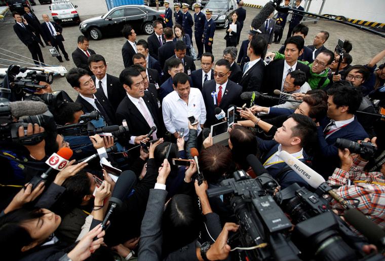Image: Philippine President Rodrigo Duterte (C) speaks to the media after his inspection at the Japan Coast Guard base in Yokohama, south of Tokyo