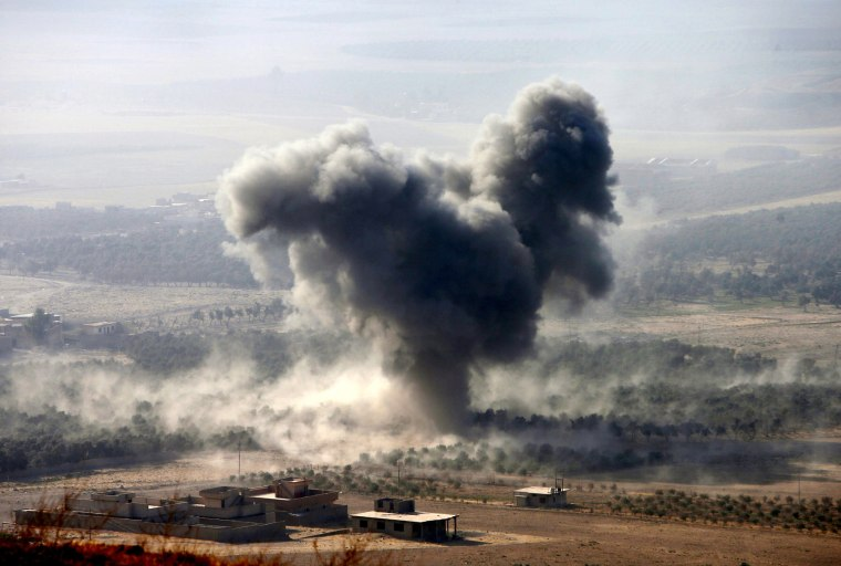 Image: Smoke rises at Islamic State militants' positions in the town of Naweran