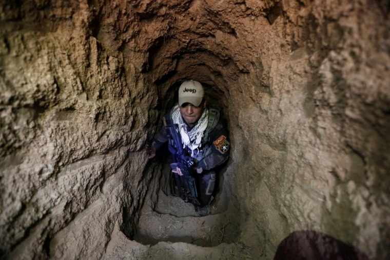 Image: An Iraqi special forces soldier is seen inside a tunnel used by Islamic State militants in Bazwaya, east of Mosul