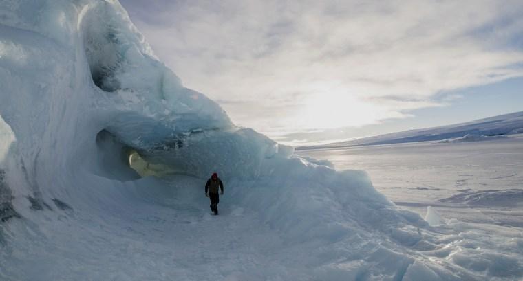 Image: A man exploring in the Ross Sea Region of Antarctica.