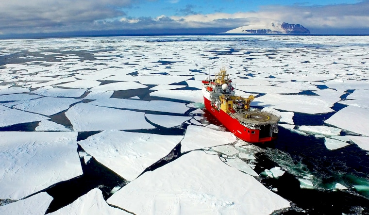 Image: A boat passes through pack ice