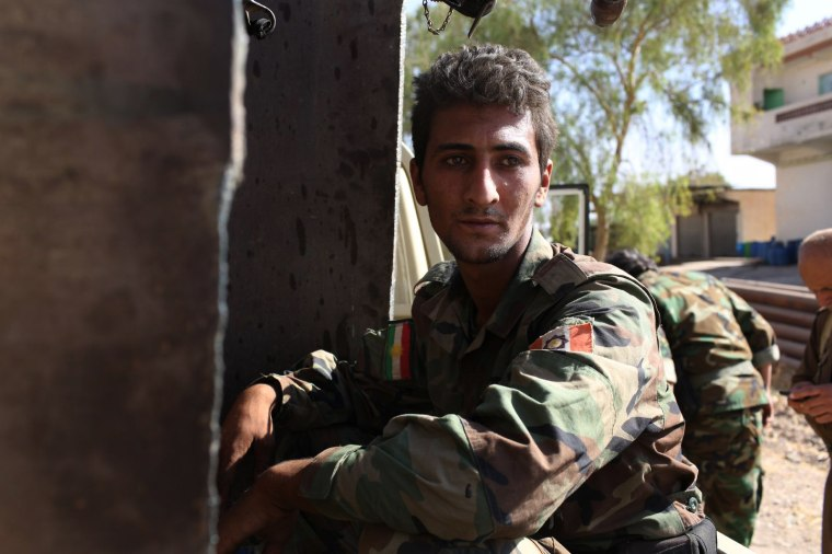 A PAK soldier rests between bursts of fighting against ISIS.