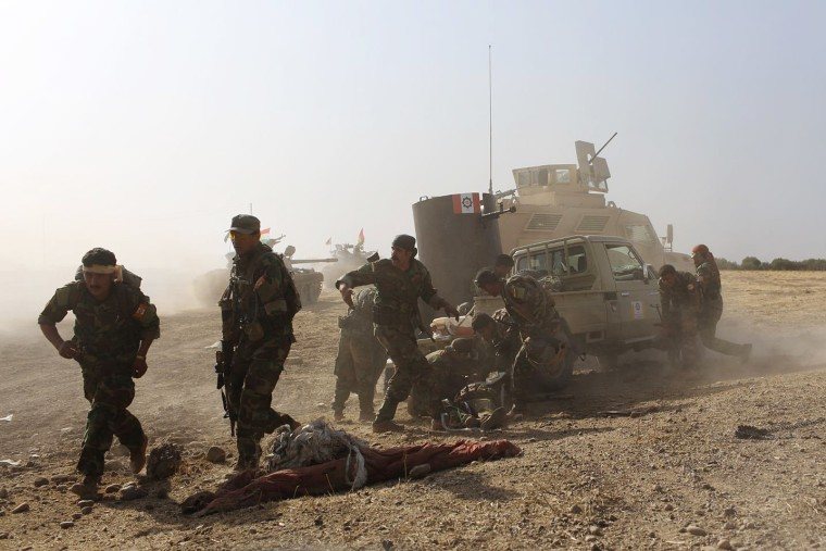 The PAK soldiers try to take shelter after moving their fallen soldiers to an armored car.