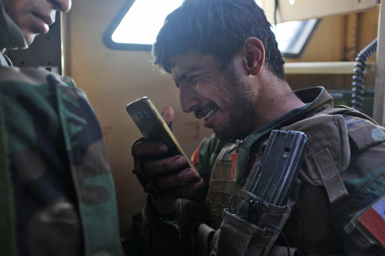 A PAK soldier is overcome with emotion as they evacuate their two shot soldiers.
