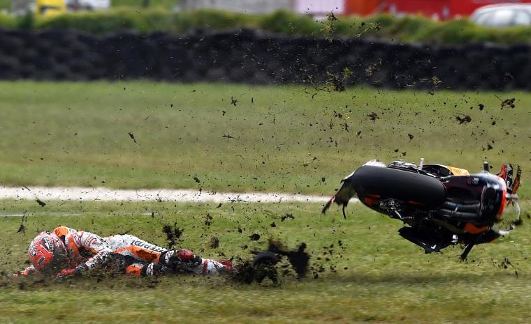 Image: Repsol Honda Team's Spanish rider Marc Marquez crashes out during the MotoGP class