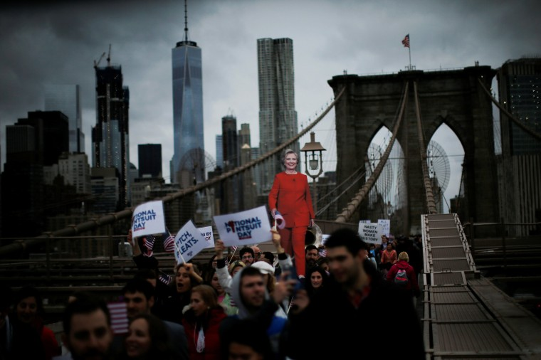 Image: Supporters of U.S. Democratic presidential nominee Hillary Clinton take part in a march through the Brooklyn bridge in New York