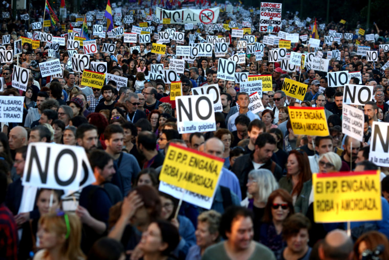Image: Demonstrators attend a protest against the investiture of acting Prime Minister and Popular Party leader Mariano Rajoy in Madrid