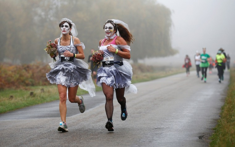 Image: Participants take part in a Trick or Treat halloween fun run in Richmond Park, London