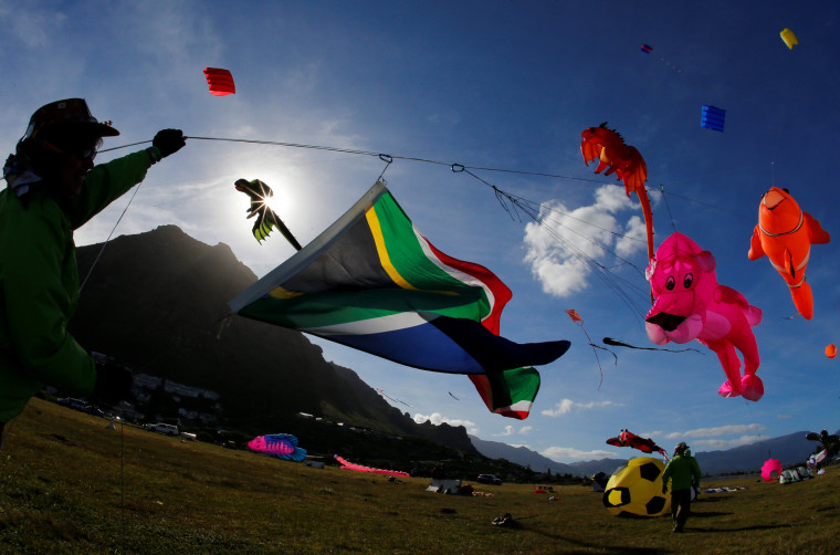 Image: Kites of all shapes and sizes fill the air at the 22nd Cape Town International Kite Festival in Cape Town, South Africa