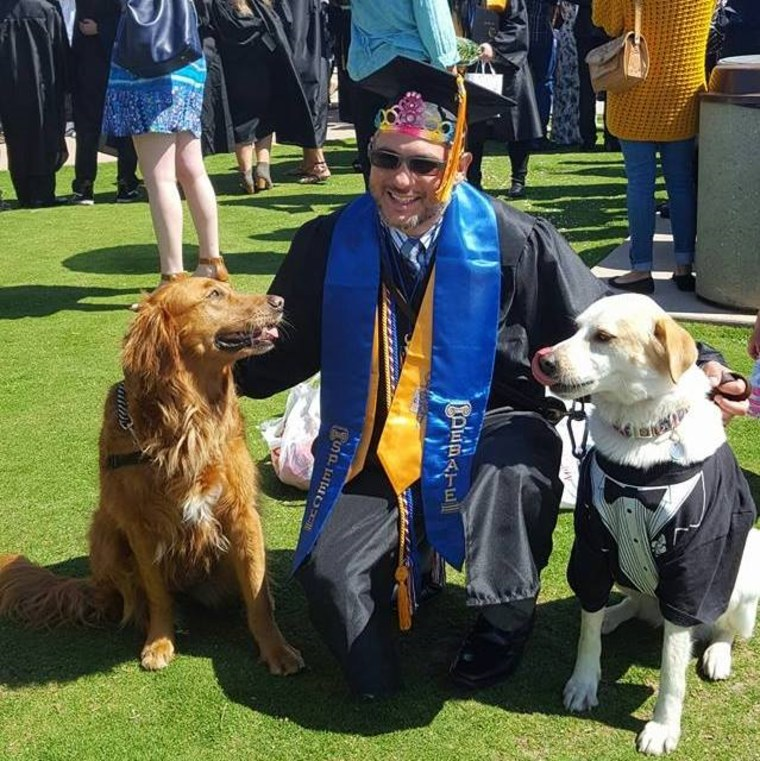 Randall Dexter with surf dog Ricochet and therapy dog Captain