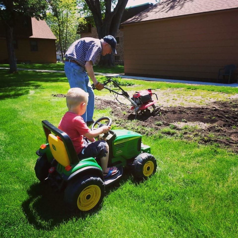 Emmett supervised as Erling attended his garden.
