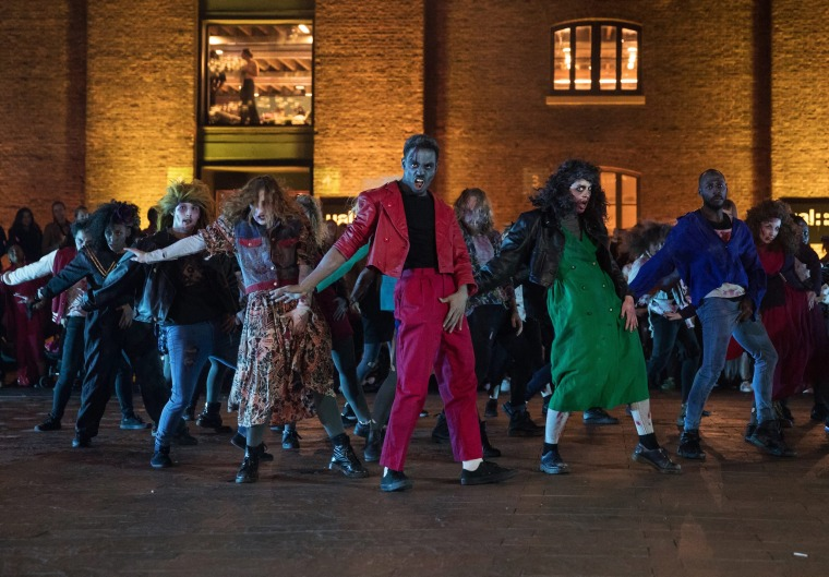 Image: 100 professional dancers perform Thriller of Michael Jackson for Halloween in London