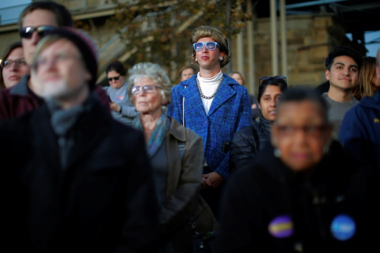 Image: A person dressed as U.S. Democratic presidential nominee Hillary Clinton stands in the crowd at a campaign rally in Cincinnati