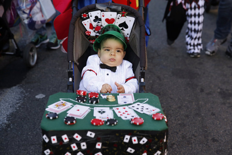 Image: A young child takes part in the Hoboken Ragamuffin Parade to celebrate Halloween in Hoboken, New Jersey