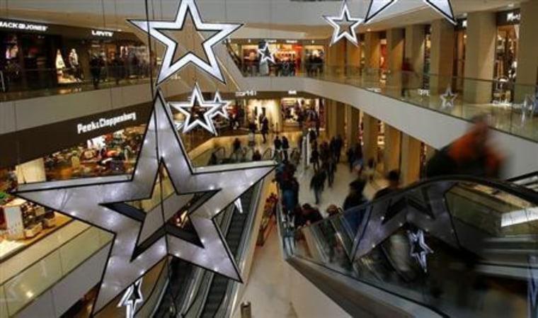 People walk through a shopping mall in the western Austrian city of Innsbruck
