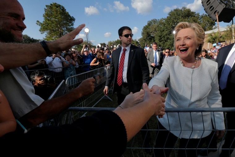 Image: U.S. Democratic presidential nominee Hillary Clinton greets audience members at a campaign rally at Pasco-Hernando State College in Dade City