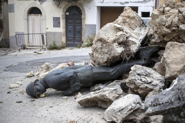 Image: Aftershocks continue in quake-ravaged central Italy