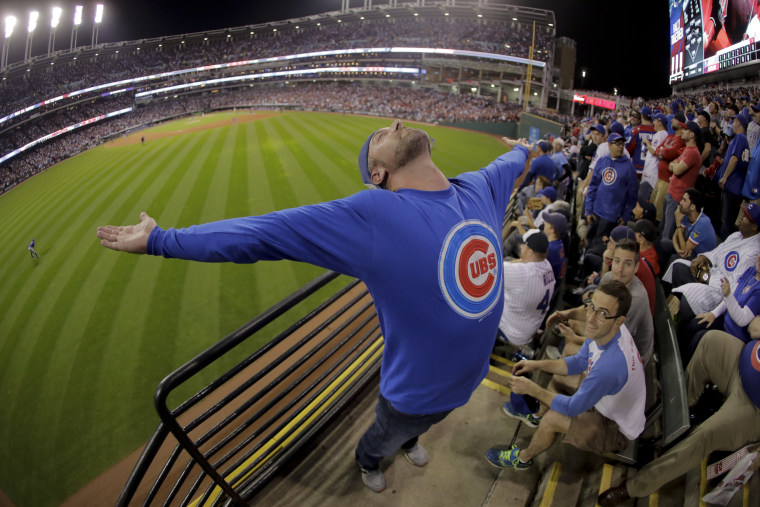 Image: A Chicago Cubs celebrates during the eighth inning of Game 7 of the Major League Baseball World Series against the Cleveland Indians