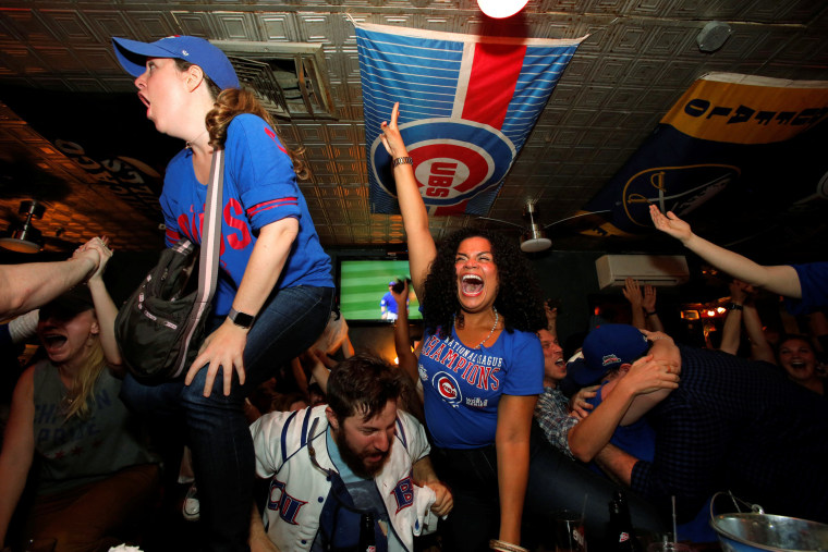 Image: Fans of National League baseball team Chicago Cubs gathered to watch the game at Kelly's bar celebrate their Major League Baseball World Series game 7 victory against American League's Cleveland Indians in Manhattan, New York U.S.