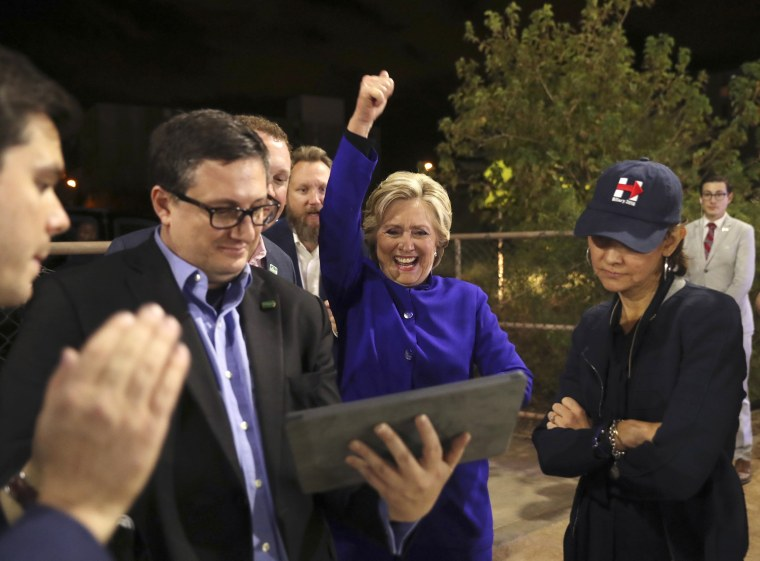 Image:  Clinton watches the World Series baseball game between the Chicago Cub and the Cleveland Indians
