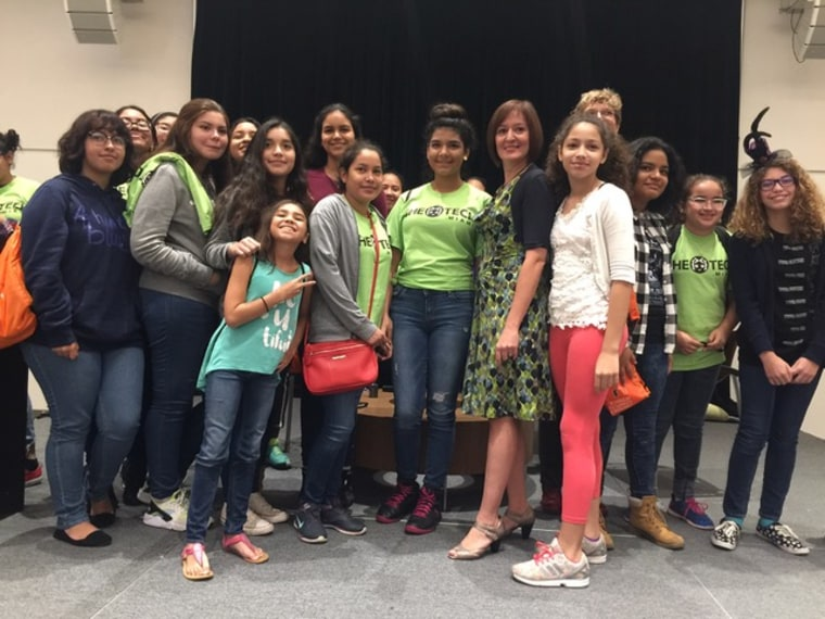 Dr. Alicia Abella with girls who wanted a picture with her.