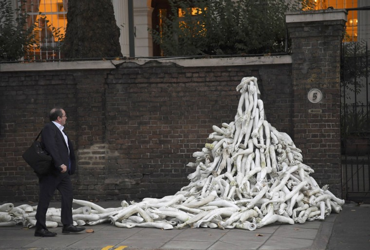 Image: Piles on mannequin limbs are seen outside the Russia's embassy in London as part of a protest against military action in Syria