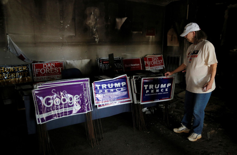 Image: Evelyn Poole-Kober views the damage caused in an arsonist attack on local offices of the North Carolina Republican Party in Hillsborough
