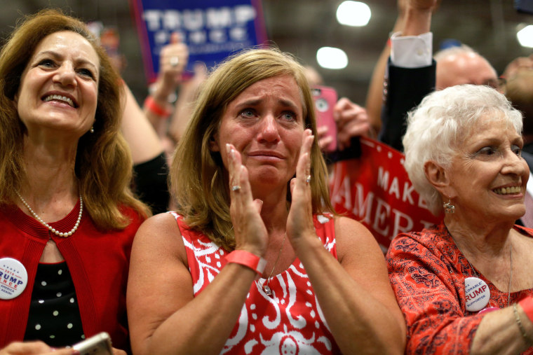 Image: A woman is moved to tears as Trump takes the stage at a campaign rally in Newtown, Pennsylvania