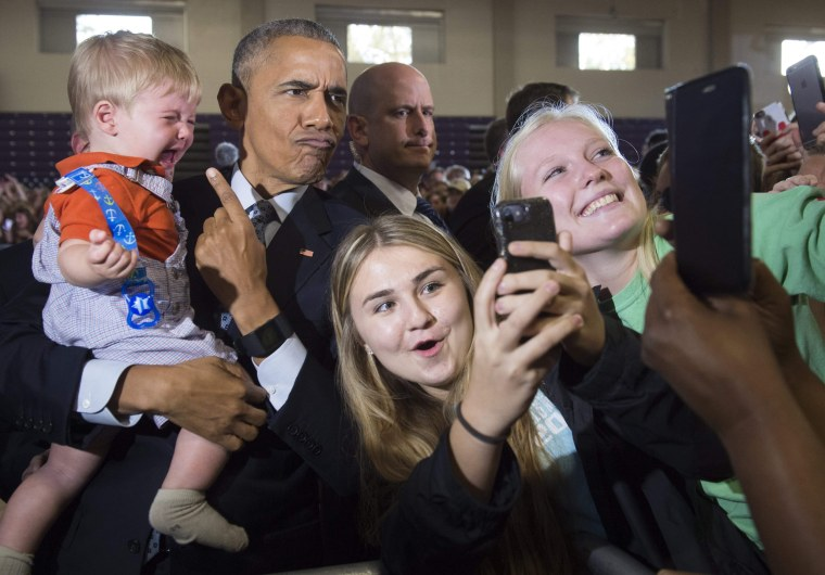 Image: Obama holds 10-month-old Brooks Breitwieser as he greets supporters