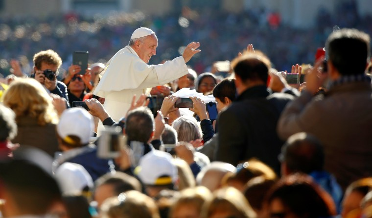 Image: Pope Francis waves as he arrives to lead a special Jubilee audience in Saint Peter's square at the Vatican