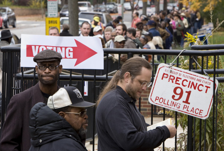 Image: People line up to vote at a polling station on election day in Washington