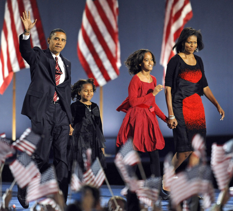 Image: President-elect Barack Obama appears on stage with his family members for his victory speech at his election party in Chicago November 4, 2008.