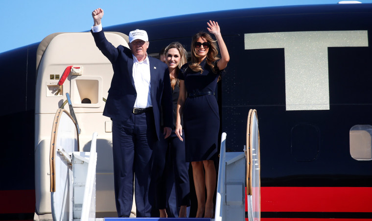 Image: Republican presidential nominee Donald Trump waves with his wife Melania Trump at a campaign rally in Wilmington