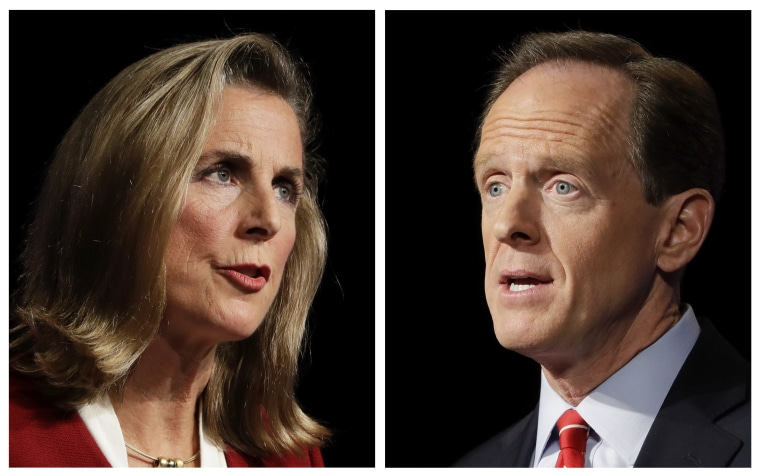 In this Monday, Oct. 24, 2016 combination of photos, Pennsylvania U.S. Senate candidates Democrat Katie McGinty, left, and Republican Sen. Pat Toomey take part in a debate at Temple University in Philadelphia.