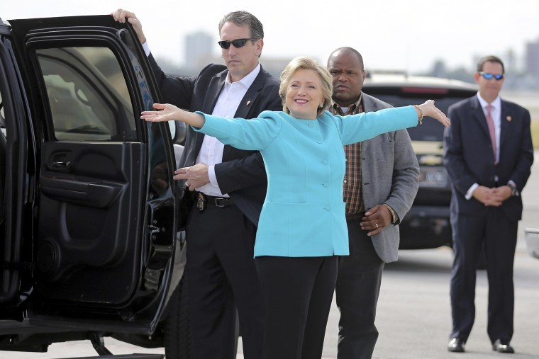 Image: U.S. Democratic presidential candidate Clinton reacts before boarding her campaign plane at Miami international airport in Miami