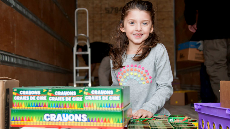 Little girl who collects boxed crayons for children's hospitals.