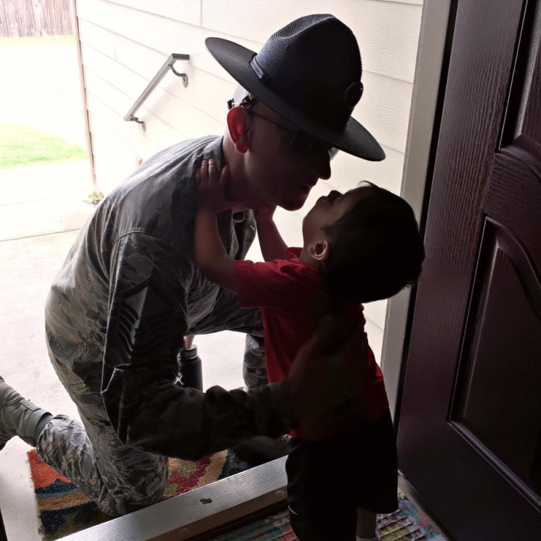 United States Air Force Master Sergeant Reymundo Marquez III saying bye to his 3-year-old son Leo.
