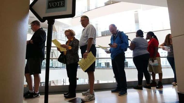 Voters wait in line for casting their ballots during early voting for the 2016 general election at Forsyth County Government Center October 28, 2016 in Winston-Salem, North Carolina.