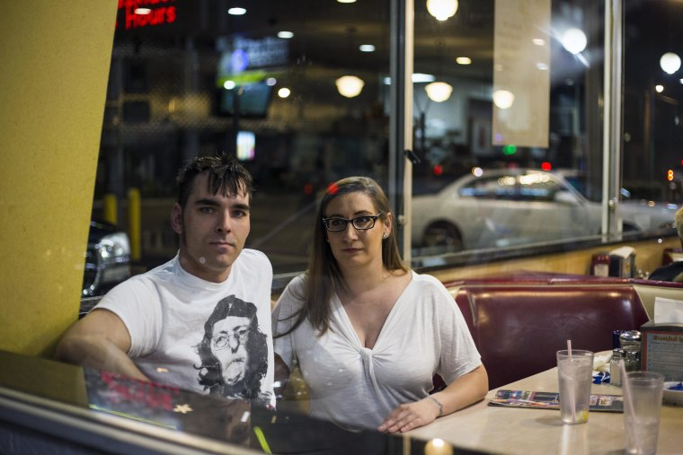 Megan Kreger, 30 and her partner, Anthony Paciorek, 33, at Starlite Coney Island, a famed diner for the residents of Flint, Michigan, on Oct. 22.
