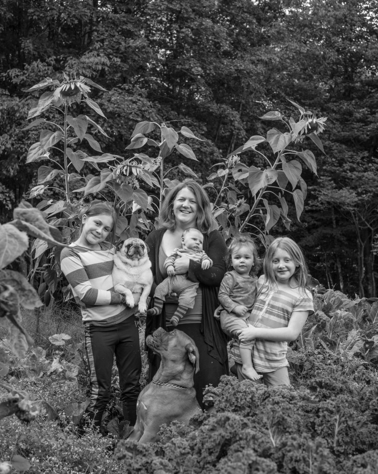 Braelyn Gillespie, 31, poses with her children and her dogs at her home in Craftsbury, Vermont.