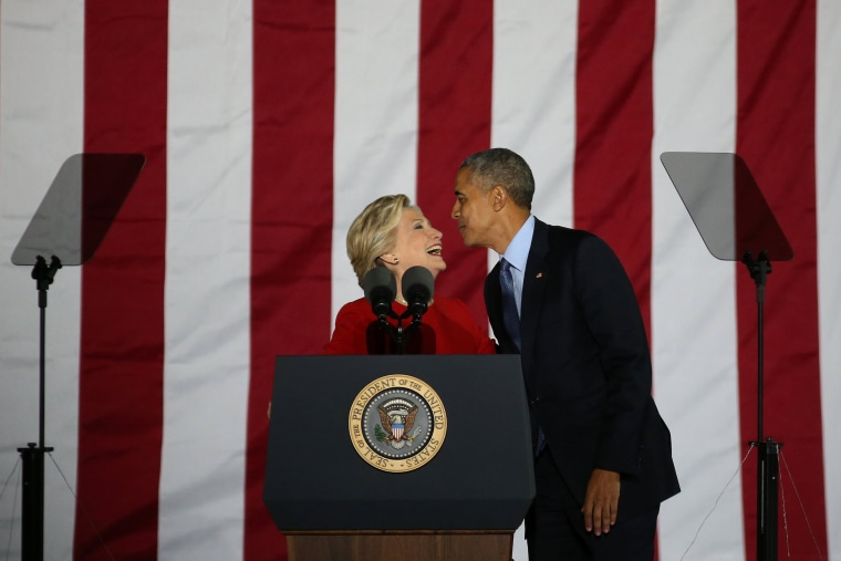 Image: U.S. Democratic presidential nominee Hillary Clinton reacts with U.S. President Barack Obama