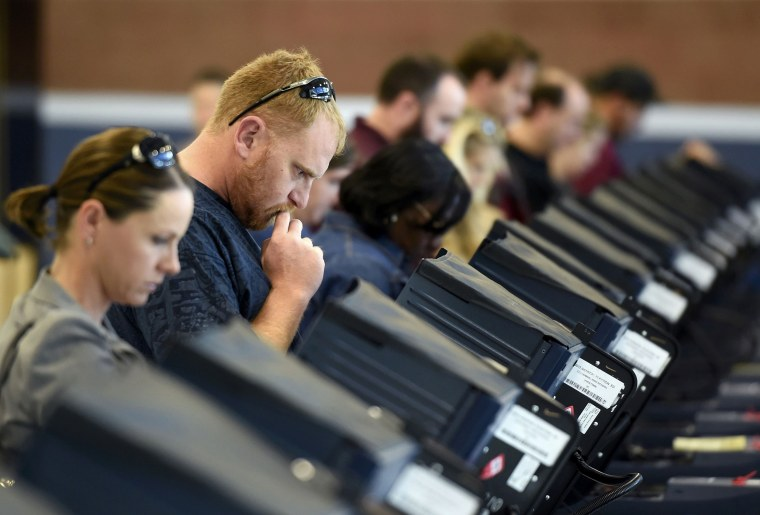Image: People cast their ballots during voting in the 2016 presidential election in Las Vegas, Nevada
