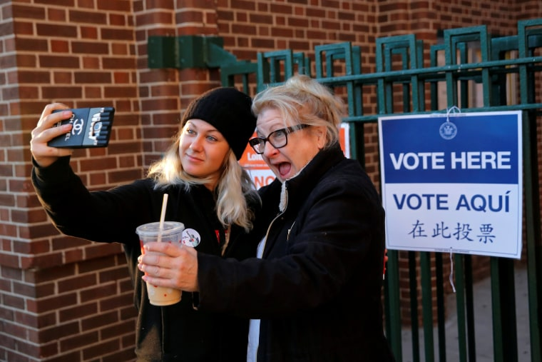 Image: First time voter Kaeli Askea with her mother Erin Collins-Askea