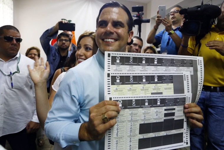 Puerto Rico Governor-Elect Ricardo Rosello (C) poses to the press before casting his vote in Guanaybo, Puerto Rico, 08 November 2016.