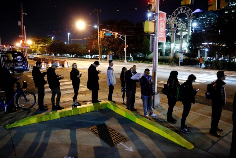 Image: People wait in line to vote during the presidential election